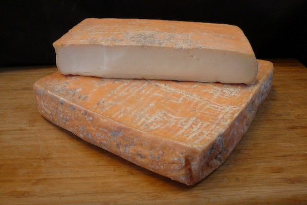Taleggio cheese cut and stacked